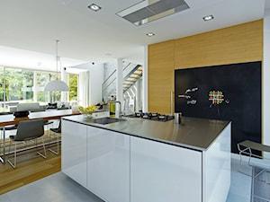 ATRAKCYJNY 1 - projekt z elewacją klinkierową - Duża beżowa czarna kuchnia jednorzędowa z wyspą, styl nowoczesny - zdjęcie od DOMY Z WIZJĄ - nowoczesne projekty domów