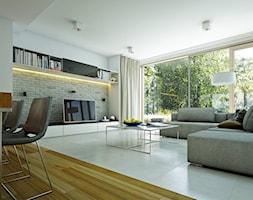 ATRAKCYJNY 1 - projekt z elewacją klinkierową - Średni biały salon z jadalnią, styl nowoczesny - zdjęcie od DOMY Z WIZJĄ - nowoczesne projekty domów