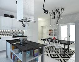 Mieszkanie 2+2koty, 70m2 - Duża zamknięta biała kuchnia jednorzędowa z wyspą z oknem, styl skandynawski - zdjęcie od A+A
