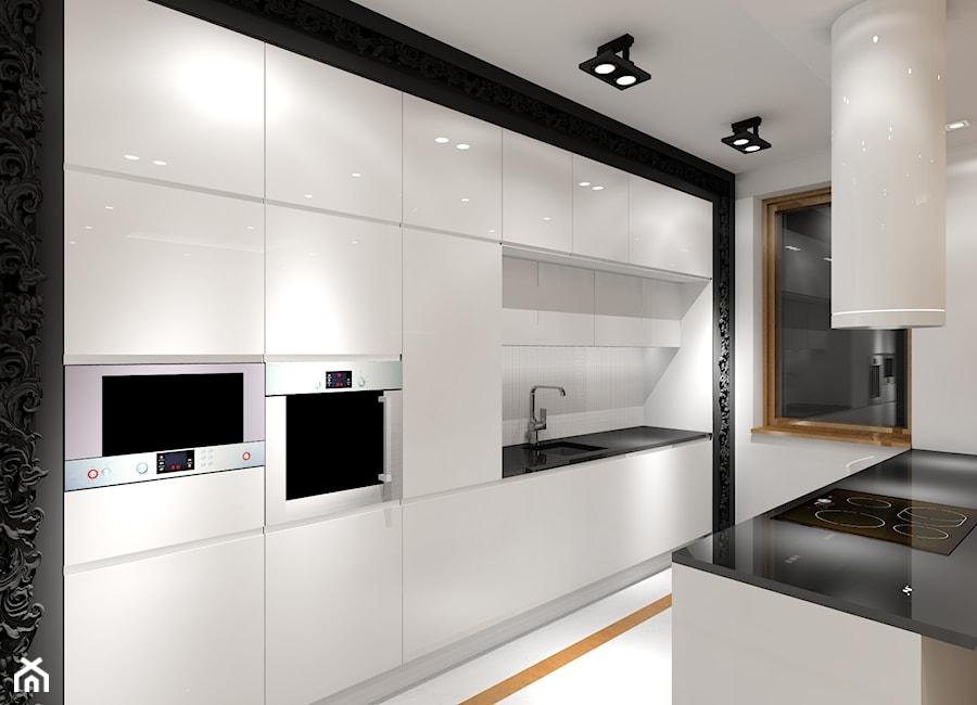 Biała kuchnia z dekoracyjną czarną ramą  zdjęcie od MKdezere