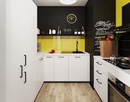 Mieszkanie 33m2 - Mała zamknięta czarna żółta kuchnia w kształcie litery u - zdjęcie od Pogotowie Wnętrzarskie