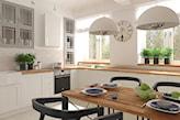 kuchnia w stylu skandynawskim, białe meble z drewnianym blatem, czarne krzesła, białe lampy wiszące