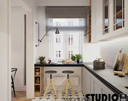 Kompaktowo w Warszawie - Średnia otwarta biała kuchnia w kształcie litery l z oknem, styl nowoczesny - zdjęcie od MIKOŁAJSKAstudio