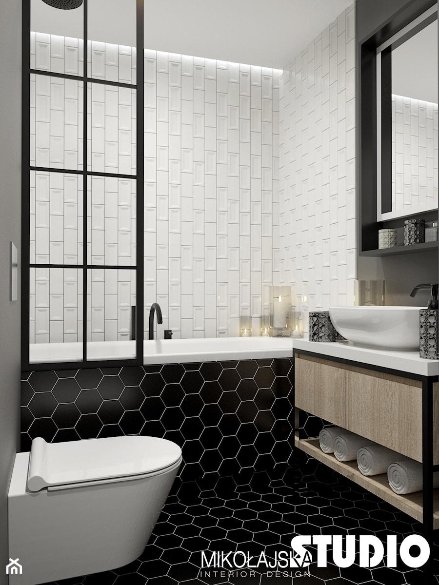 Mieszkanie przy Ślusarskiej - Mała biała czarna szara łazienka w bloku w domu jednorodzinnym bez okna, styl nowoczesny - zdjęcie od MIKOŁAJSKAstudio