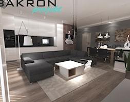 pokój dzienny z aneksem kuchennym - zdjęcie od BAKRON PROJEKT