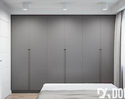 Minimalistyczne mieszkanie - Średnia szara sypialnia małżeńska, styl minimalistyczny - zdjęcie od Dom-Art - Homebook