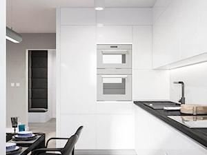Minimalistyczne mieszkanie - Duża otwarta kuchnia w kształcie litery l w aneksie, styl minimalistyczny - zdjęcie od Dom-Art