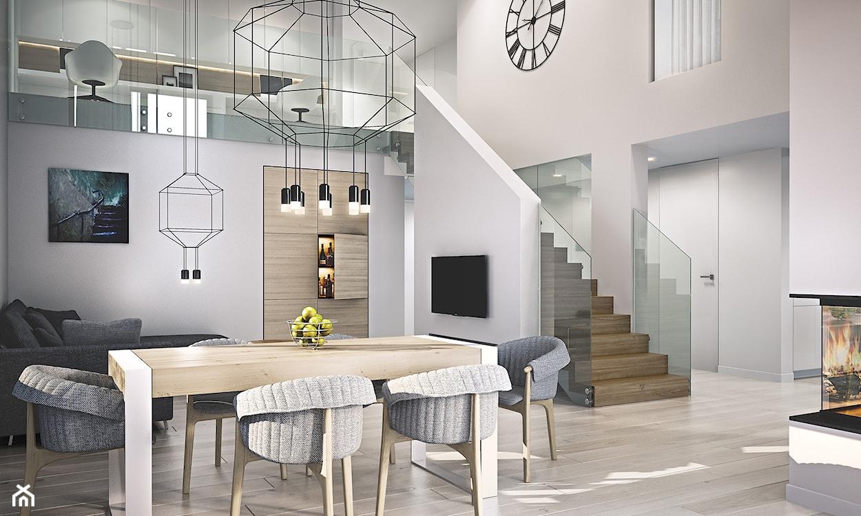 duży nowoczesny salon z kącikiem jadalnianym