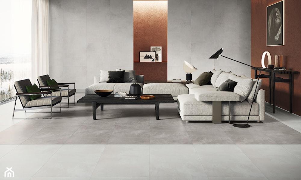 szare płytki na podłodze i na ścianie w salonie