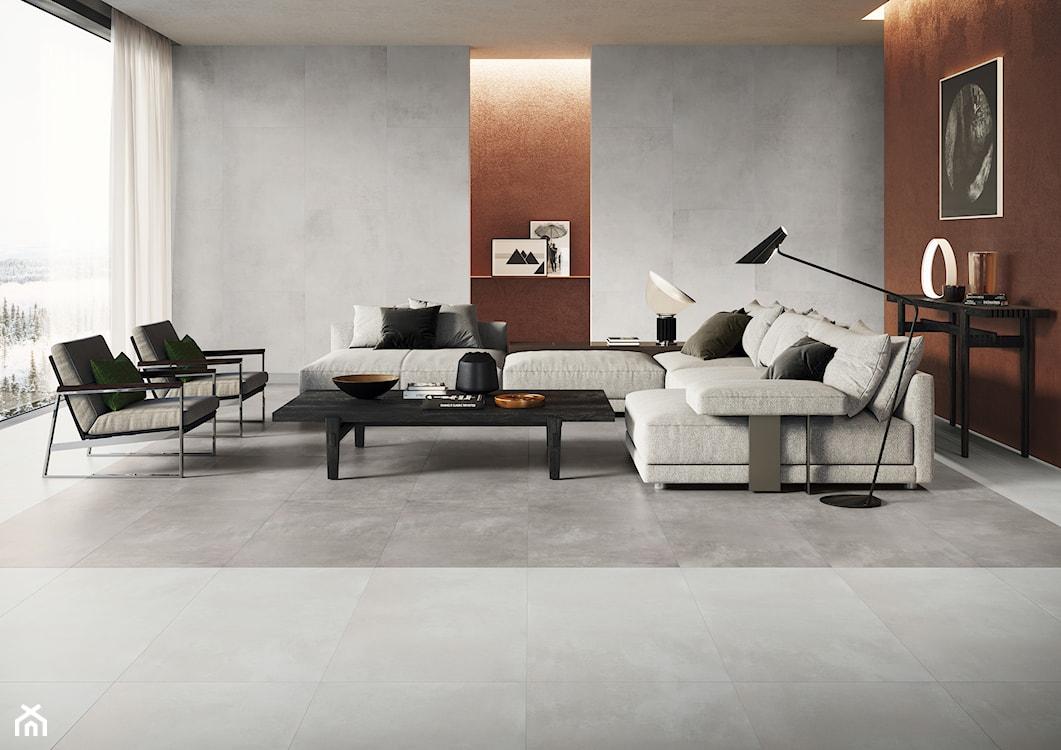 szary salon, salon w stylu industrialnym, płytki na ścianie w salonie, płytki imitujące beton