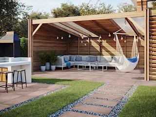 Jak zaaranżować przestrzeń wokół domu przy pomocy płytek gresowych imitujących beton?