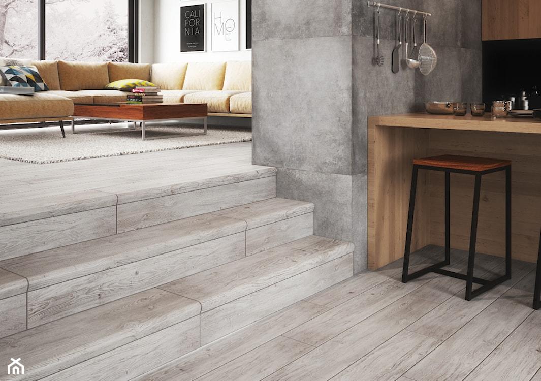 salon w stylu industrialnym, płytki drewnopodobne, schody wewnętrzne