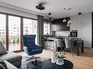 Apartament Altoria 2 - Gdynia - Średni biały salon z barkiem z kuchnią z jadalnią z tarasem / balkonem, styl nowoczesny - zdjęcie od Anna Serafin Architektura Wnętrz
