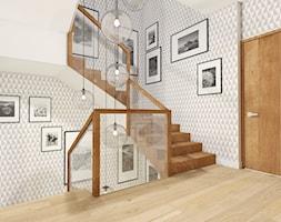 Dom szeregowy na Osiedlu Bajkowym w Olsztynie - Średnie wąskie schody wachlarzowe drewniane, styl nowoczesny - zdjęcie od PRACOVNIA Projektowanie wnętrz