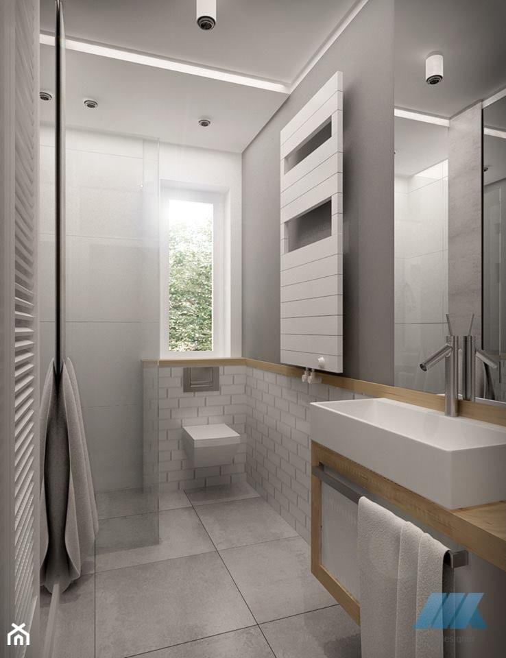 DOM DLA CZTEROOSOBOWEJ RODZINY - Średnia biała szara łazienka na poddaszu w bloku w domu jednorodzinnym z oknem, styl skandynawski - zdjęcie od MKdesigner