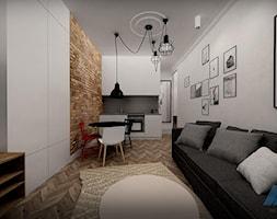ZABYTKOWA KAMIENICA W CENTRUM WARSZAWY - Mały szary biały brązowy salon z kuchnią z jadalnią, styl industrialny - zdjęcie od MKdesigner