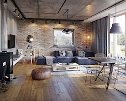 Salon z cegłą na ścianie