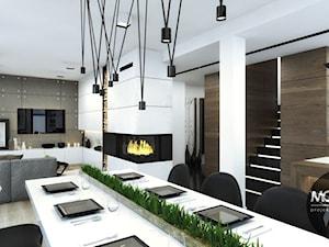 Jadalnia otwarta na kuchnię i salon - zdjęcie od MONOstudio