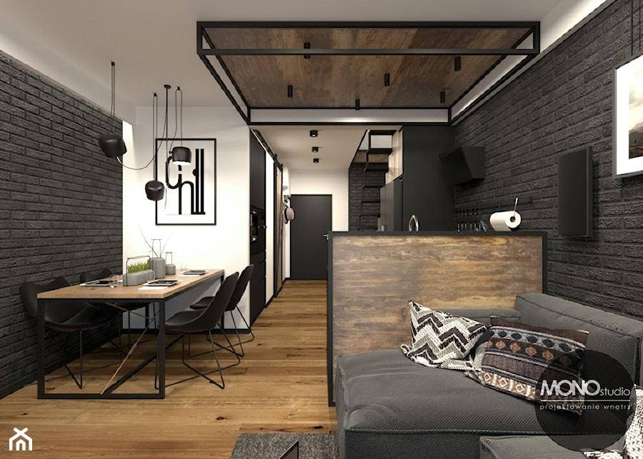 Jadalnia z salonem w klimacie industrialnym - zdjęcie od MONOstudio