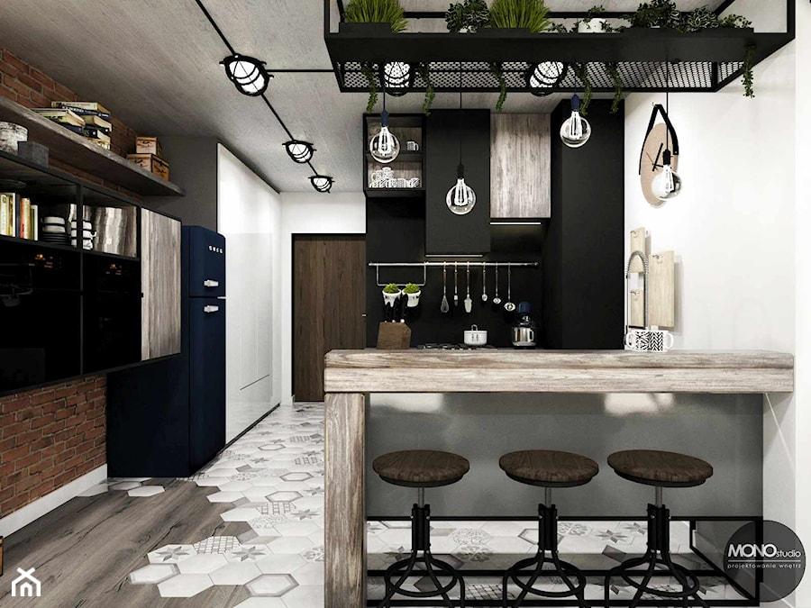 Aranżacje wnętrz - Kuchnia: przestrzeń & faktura - Średnia otwarta czarna kuchnia, styl vintage - MONOstudio. Przeglądaj, dodawaj i zapisuj najlepsze zdjęcia, pomysły i inspiracje designerskie. W bazie mamy już prawie milion fotografii!
