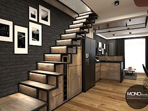 Kuchnia z salonem w klimacie industrialnym - zdjęcie od MONOstudio