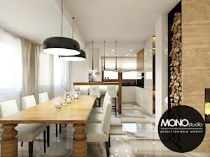 Nowoczesna otwarta na salon kuchnia w minimalistycznym charakterze