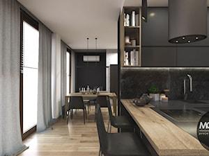 Nowczesne mieszkanie - Średnia otwarta czarna kuchnia w kształcie litery l z wyspą - zdjęcie od MONOstudio