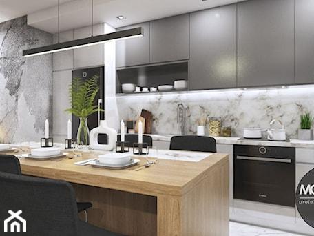 Aranżacje wnętrz - Kuchnia: Kuchnia w klimacie nowoczesnym - MONOstudio. Przeglądaj, dodawaj i zapisuj najlepsze zdjęcia, pomysły i inspiracje designerskie. W bazie mamy już prawie milion fotografii!