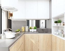 Kuchnia w bieli i drewnie - zdjęcie od MONOstudio