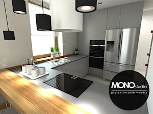 Nowoczesna minimalistyczna kuchnia w jasnej tonacji .