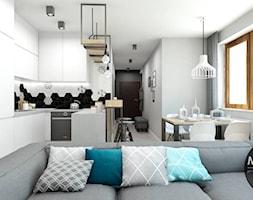Wnętrze w jasnych barwach bieli i szarości - zdjęcie od MONOstudio
