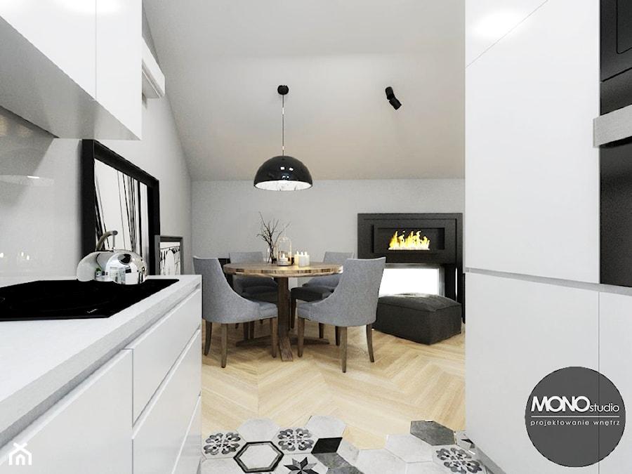 Stylowe mieszkanie z antresolą - Mała otwarta biała jadalnia w salonie, styl minimalistyczny - zdjęcie od MONOstudio