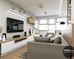 Ciepły i jasny salon w nowoczesnym klimacie - zdjęcie od MONOstudio