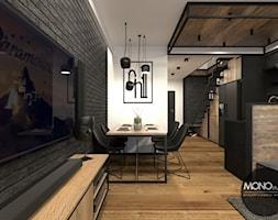 Jadalnia+z+salonem+i+kuchni%C4%85+w+klimacie+industrialnym+-+zdj%C4%99cie+od+MONOstudio