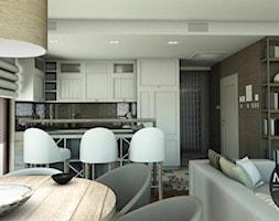 Salon otwarty na kuchnię i jadalnię - zdjęcie od MONOstudio