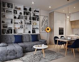 50 m2 - Średni biały salon z bibiloteczką z kuchnią z jadalnią, styl nowoczesny - zdjęcie od Idea by Mag. - Homebook