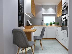 Metamorfoza Pruszków. - Mała zamknięta biała kuchnia w kształcie litery g w aneksie z wyspą z oknem, styl nowoczesny - zdjęcie od Idea by Mag.