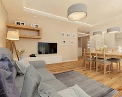 Przytulnie i rodzinnie. - Średni biały pomarańczowy salon z kuchnią z jadalnią, styl klasyczny - zdjęcie od Idea by Mag.