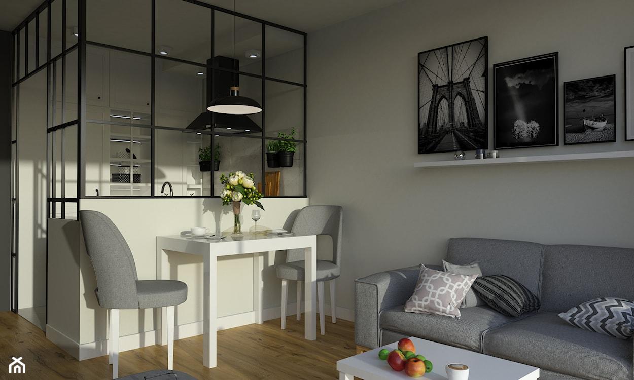 szara sofa, czarna lampa wisząca, biały stół, szare krzesła