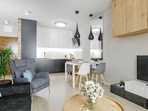 Mieszkanie Łódź - Chojny Park - Średnia otwarta biała szara jadalnia w kuchni w salonie, styl nowoczesny - zdjęcie od Klaudia Tworo Projektowanie Wnętrz