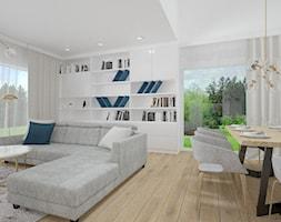 Dom w Jarocinie - Duży biały salon z bibiloteczką z jadalnią, styl nowoczesny - zdjęcie od Klaudia Tworo Projektowanie Wnętrz - Homebook
