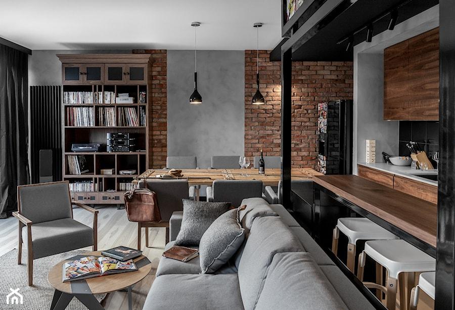 Apartament w Gdańsku - Duży szary czarny salon z kuchnią z jadalnią, styl nowoczesny - zdjęcie od SIKORA
