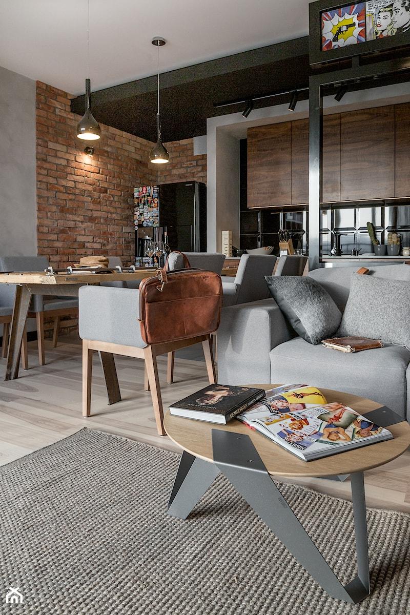 Apartament w Gdańsku - Średnia otwarta szara jadalnia w kuchni w salonie, styl nowoczesny - zdjęcie od SIKORA