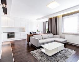 apartament 55 - Średni szary salon z kuchnią z jadalnią, styl minimalistyczny - zdjęcie od emDesign home & decoration
