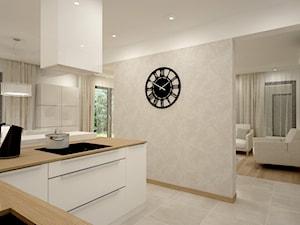 Dom w jasnych barwach - Średnia otwarta szara kuchnia w kształcie litery u w aneksie z oknem, styl nowoczesny - zdjęcie od Miliart Studio