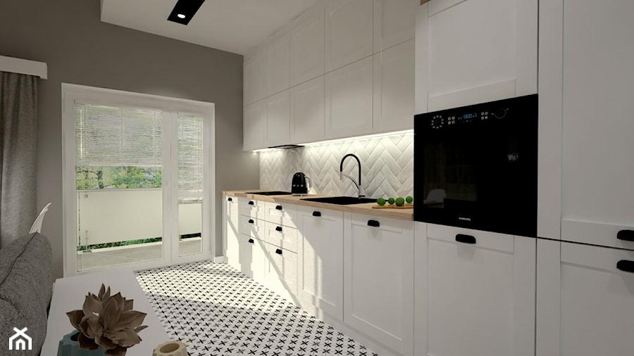 Mieszkanie na poddaszu w stylu skandynawskim - Średnia otwarta biała szara kuchnia jednorzędowa z wyspą z oknem, styl skandynawski - zdjęcie od Miliart Studio