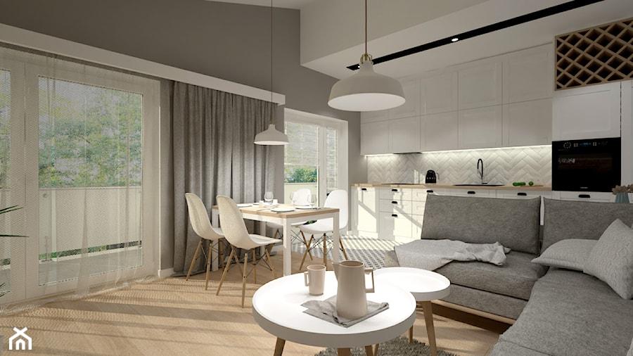 Mieszkanie na poddaszu w stylu skandynawskim - Średni szary salon z kuchnią z jadalnią, styl skandynawski - zdjęcie od Miliart Studio