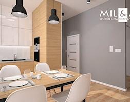 Apartament na warszawskim Ursynowie. - Mała szara kuchnia w kształcie litery l, styl industrialny - zdjęcie od Miliart Studio