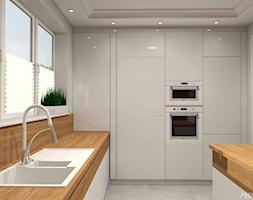 Kuchnia w domu jednorodzinnym - Średnia otwarta szara kuchnia w kształcie litery l z wyspą z oknem, ... - zdjęcie od Atelier Art&Design - Homebook