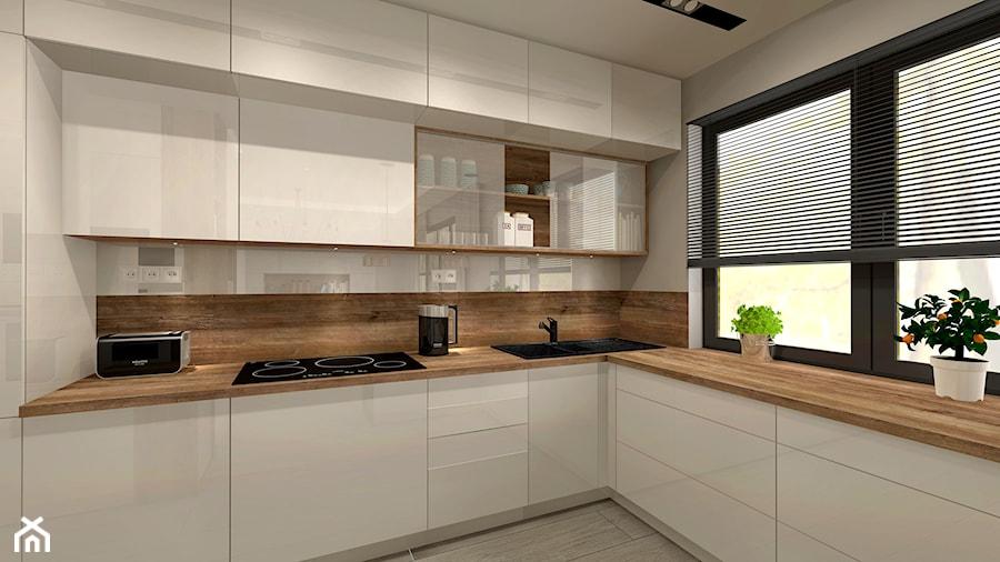 Aranżacja kuchni i salonu w domu jednorodzinnym  Średnia kuchnia w kształcie